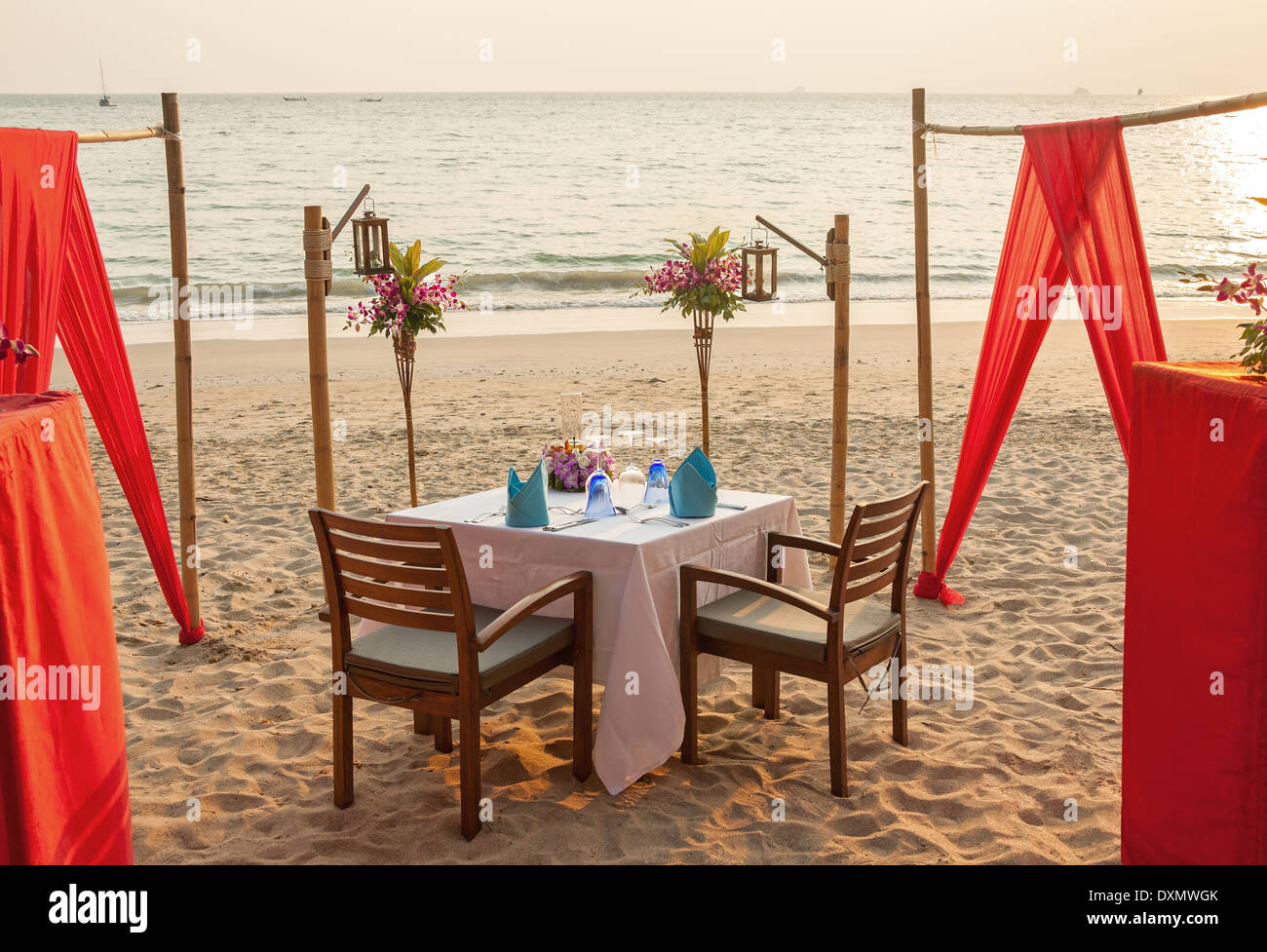 Restaurant table for two - Romantic Evening Table For Two Persons On The Beach