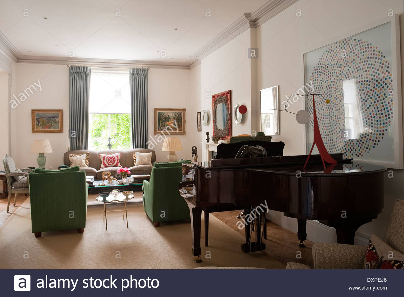Baby grand piano in living room with damien hirst print for Baby grand piano in living room