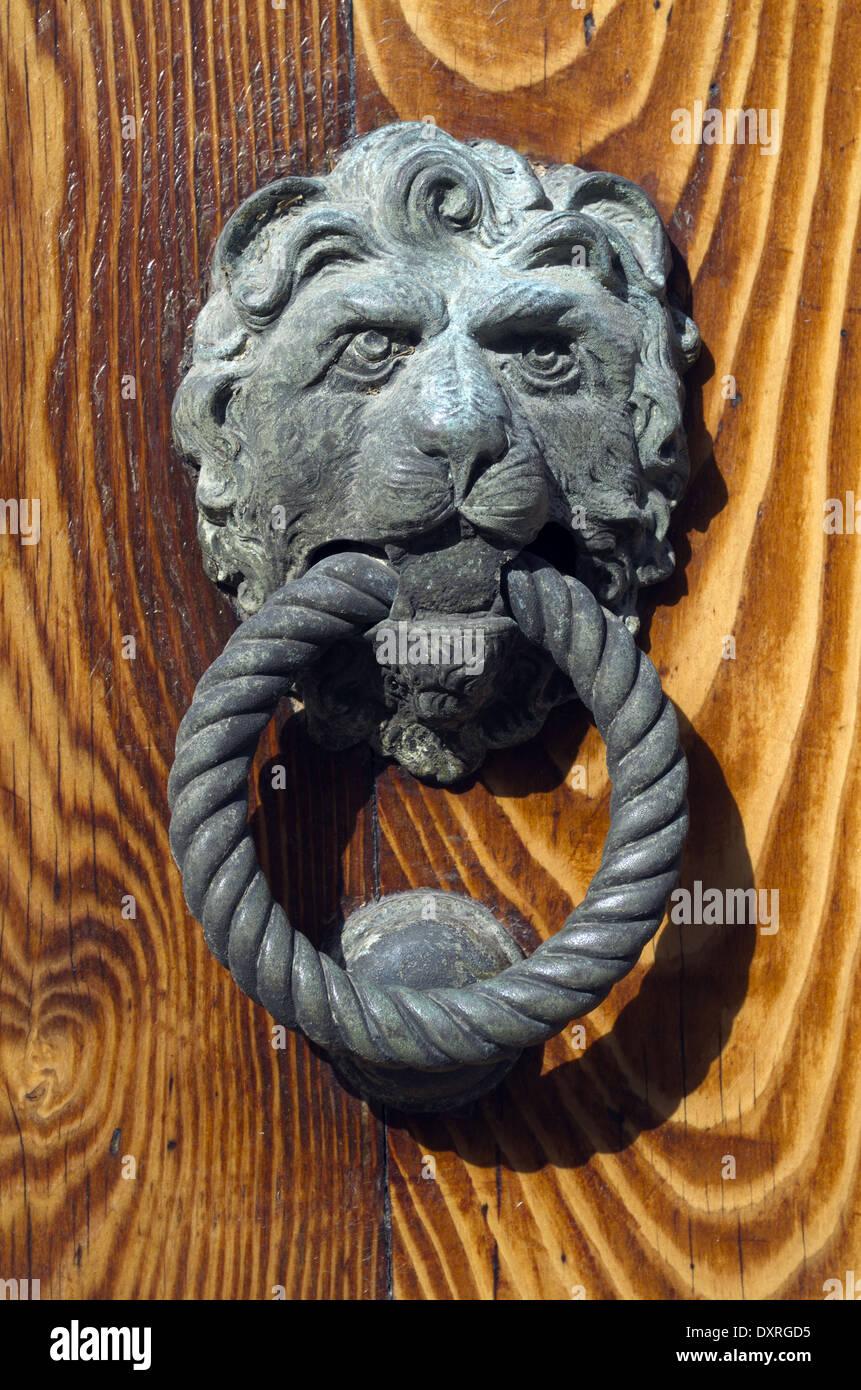 Traditional Venetian gilded lion head door knob in Venice on the ...