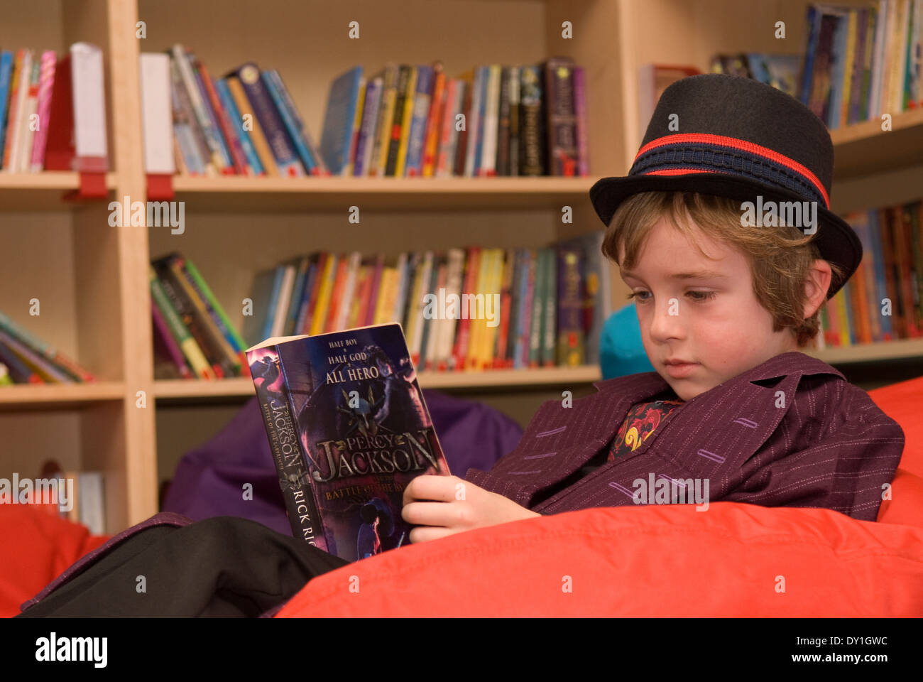 Worksheet Books 7 Year Old 7 year old pupil reading in school library costume for world book day haslemere surrey uk