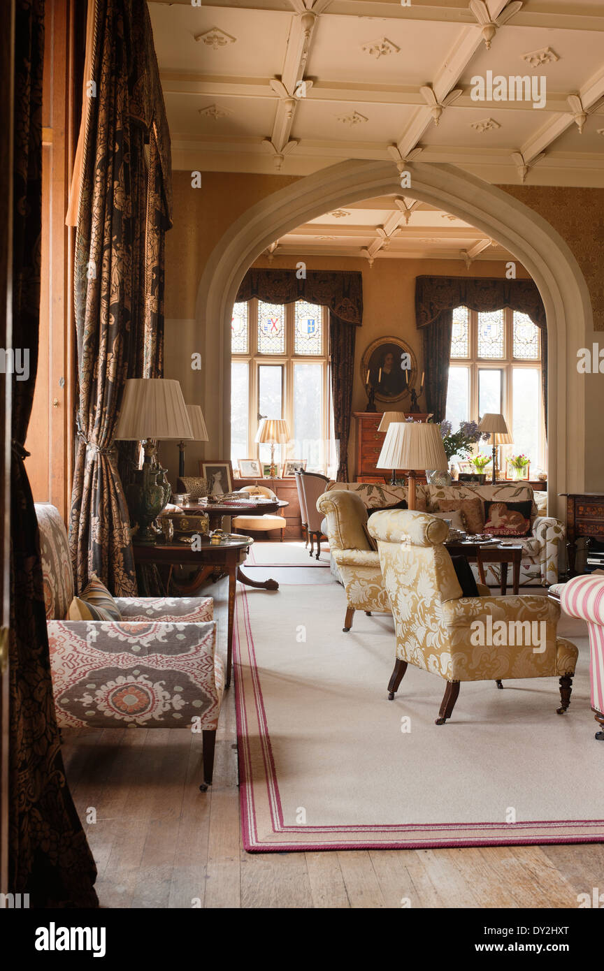 Living Room With Gilt Framed Portraits, Stucco Ceiling And Assorted Antique  Furniture Items