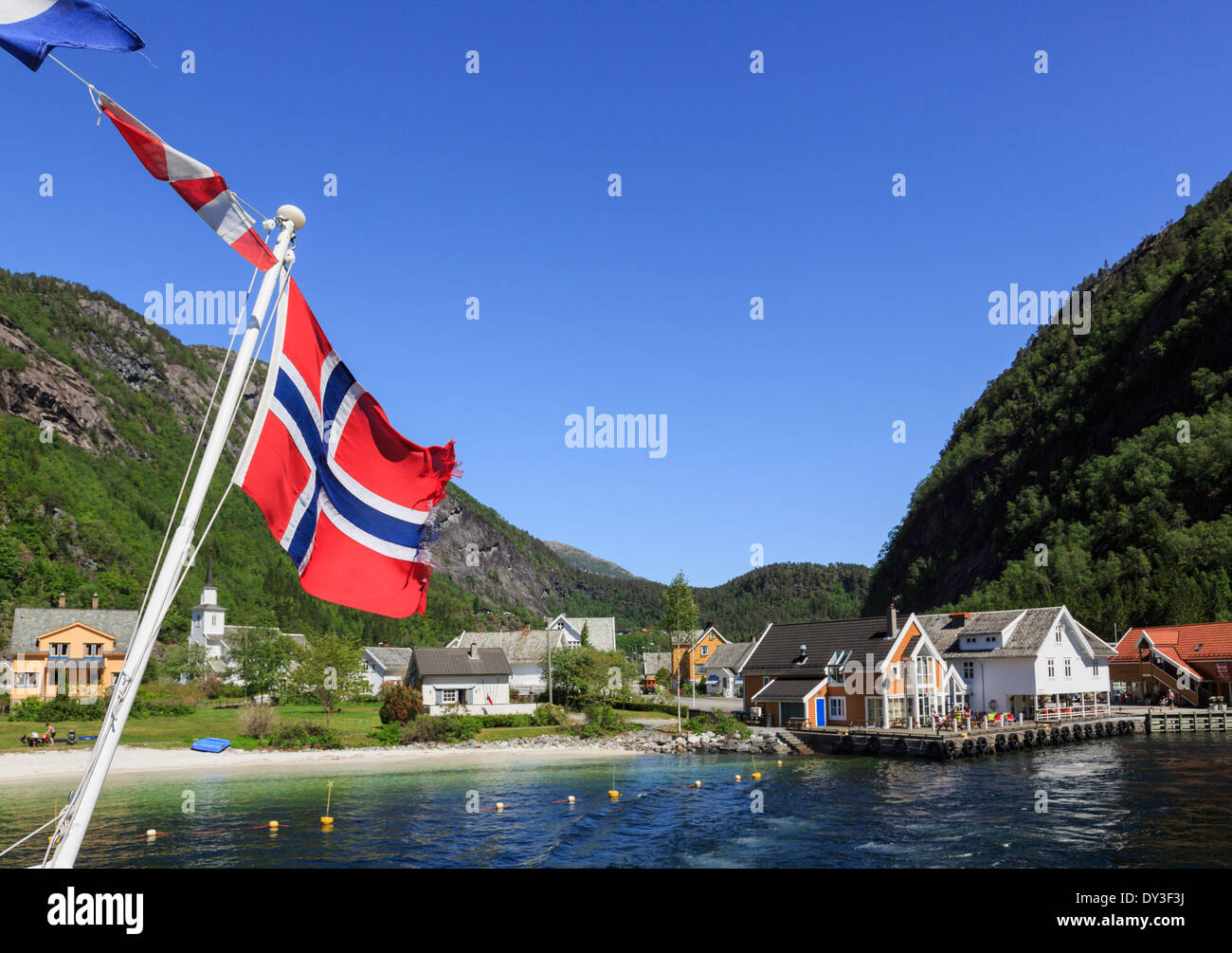 norway flag on sightseeing boat on mofjorden leaving pretty