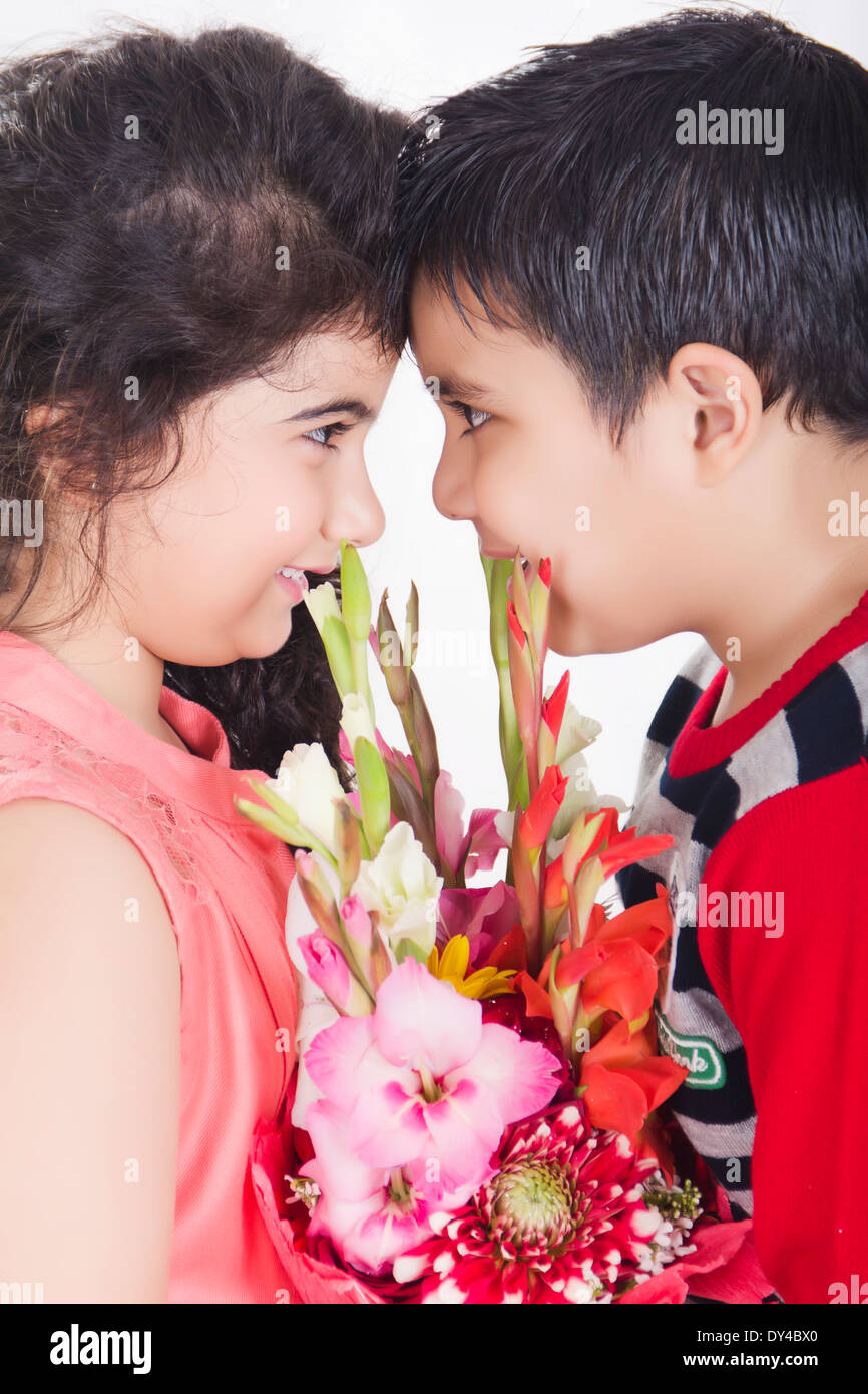 indian kids couple bouquet presents stock photo royalty free