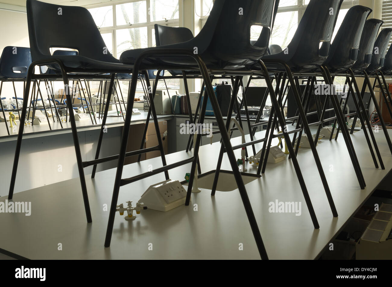Classroom chairs stacked - An Empty Classroom Science Lab With Chairs Stacked On Benches As Closure And Holidays