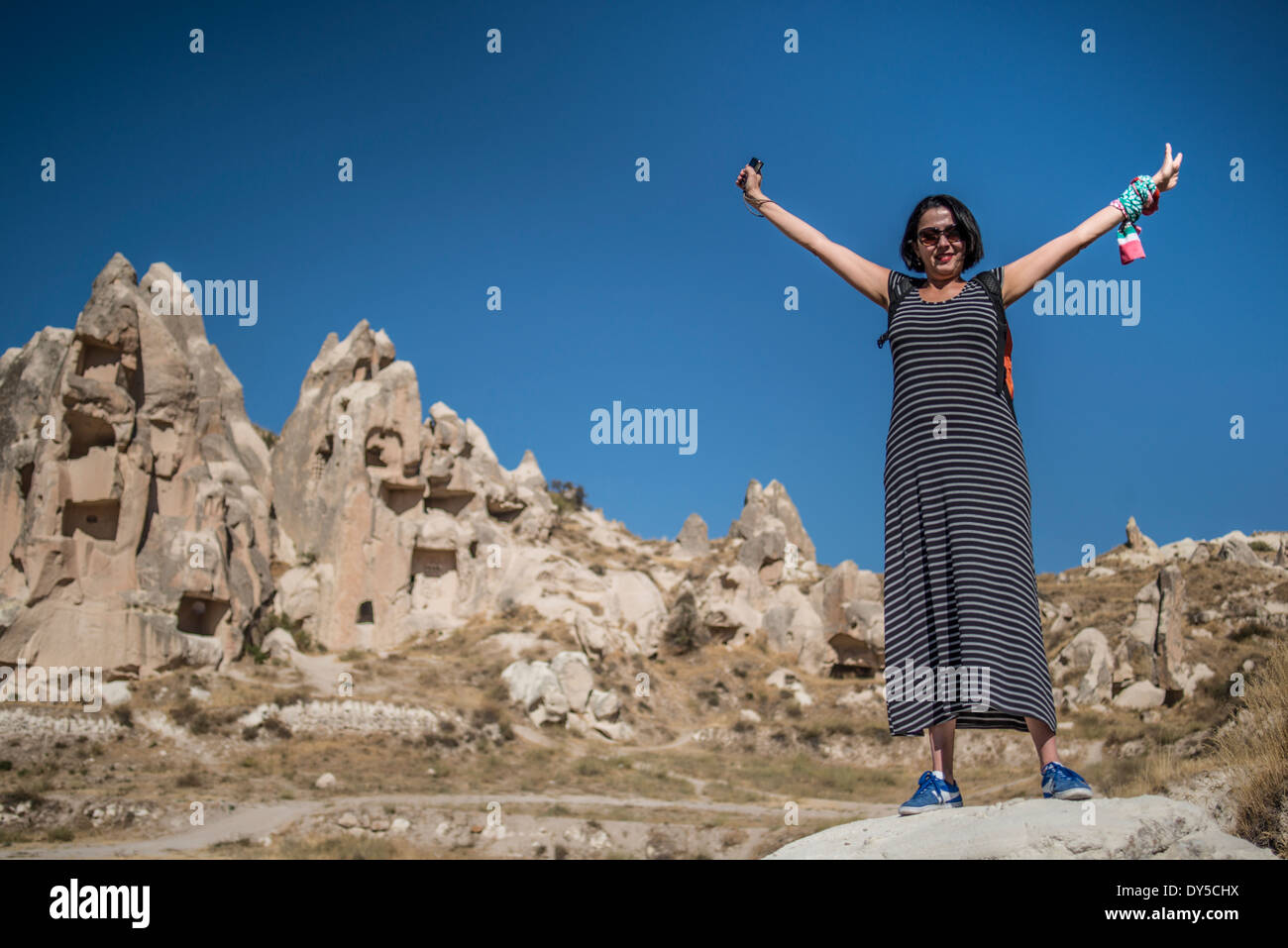 A turist at visiting the Goreme National Park in ...