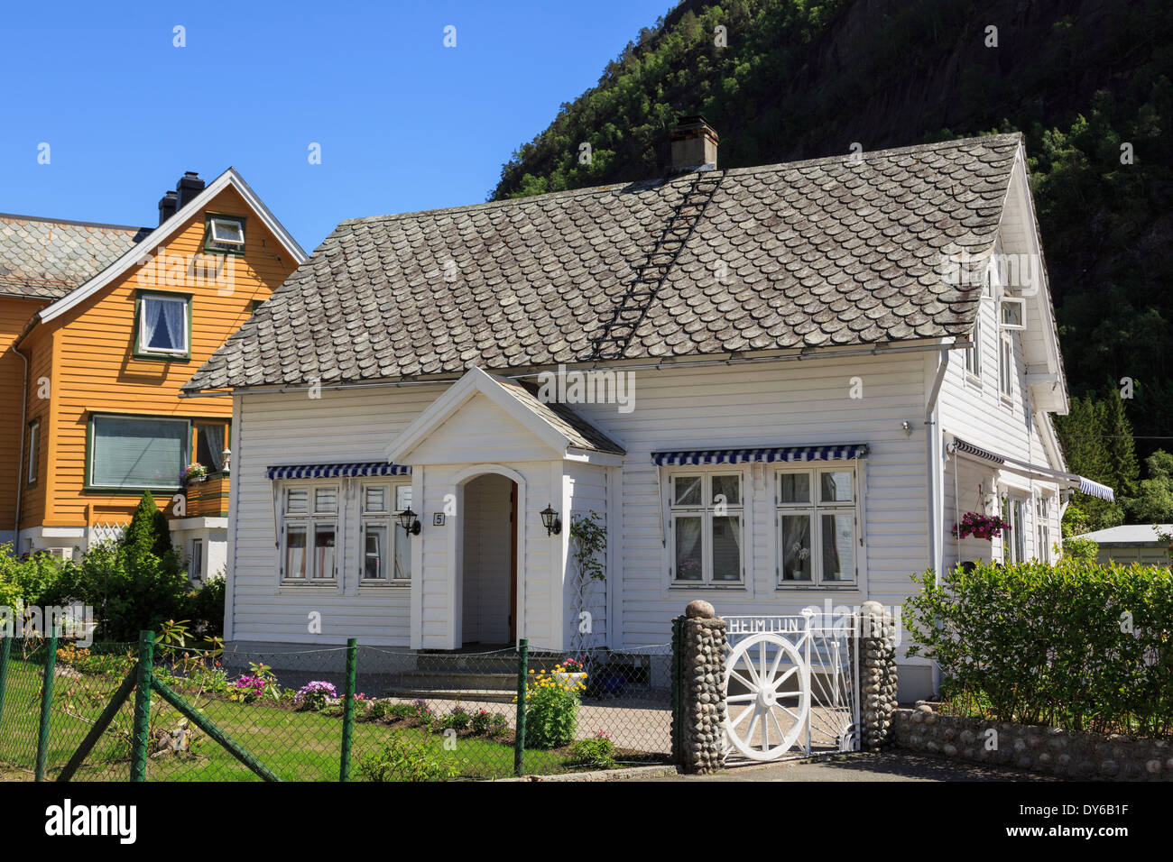 Traditional norwegian white wooden house in the small for Norway wooden houses
