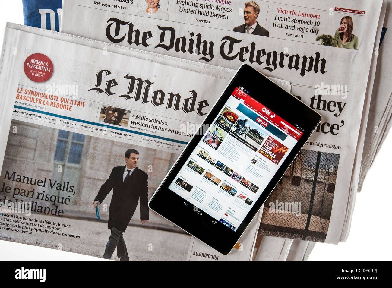 Stock photo touchscreen digital tablet with cnn international news and british the daily telegraph and french le monde european newspapers