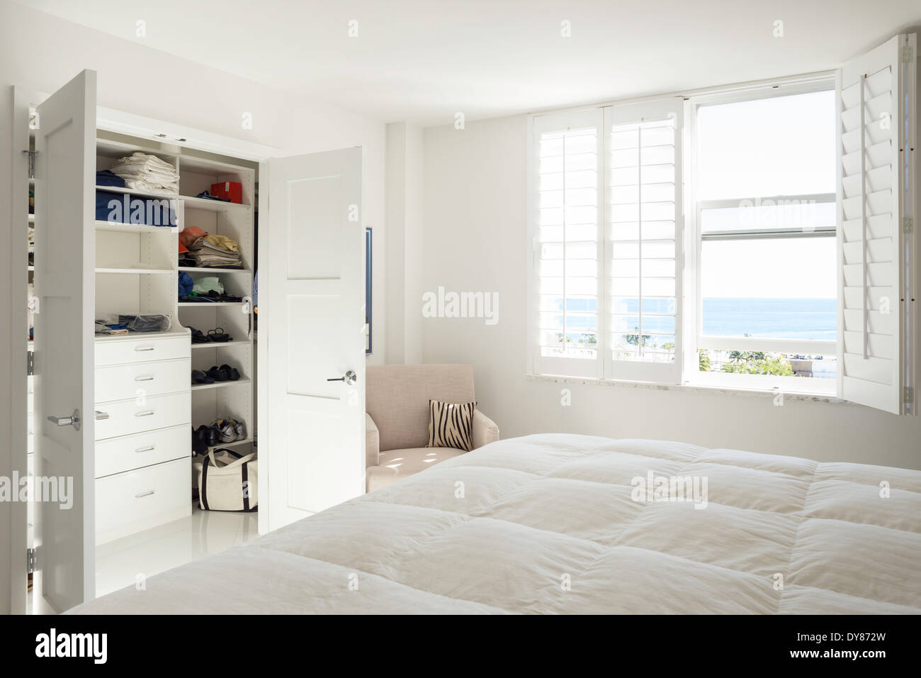 All White Sunny Bright Showcase Master Bedroom With Built In Stock Photo Royalty Free Image