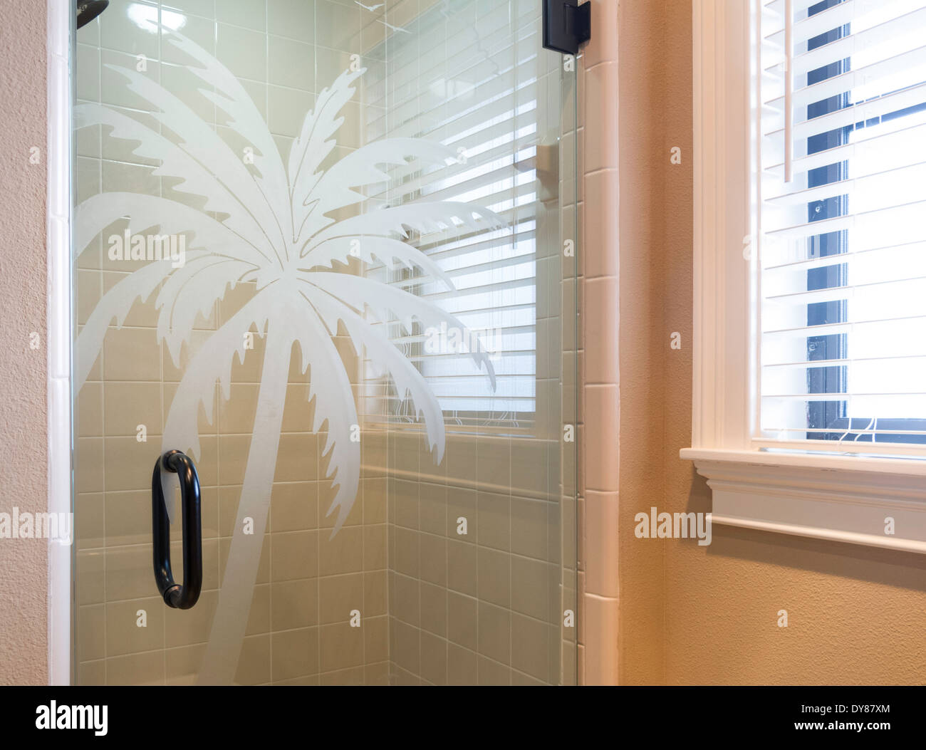 Showcase Bathroom With Glass Shower Door With Etched Palm