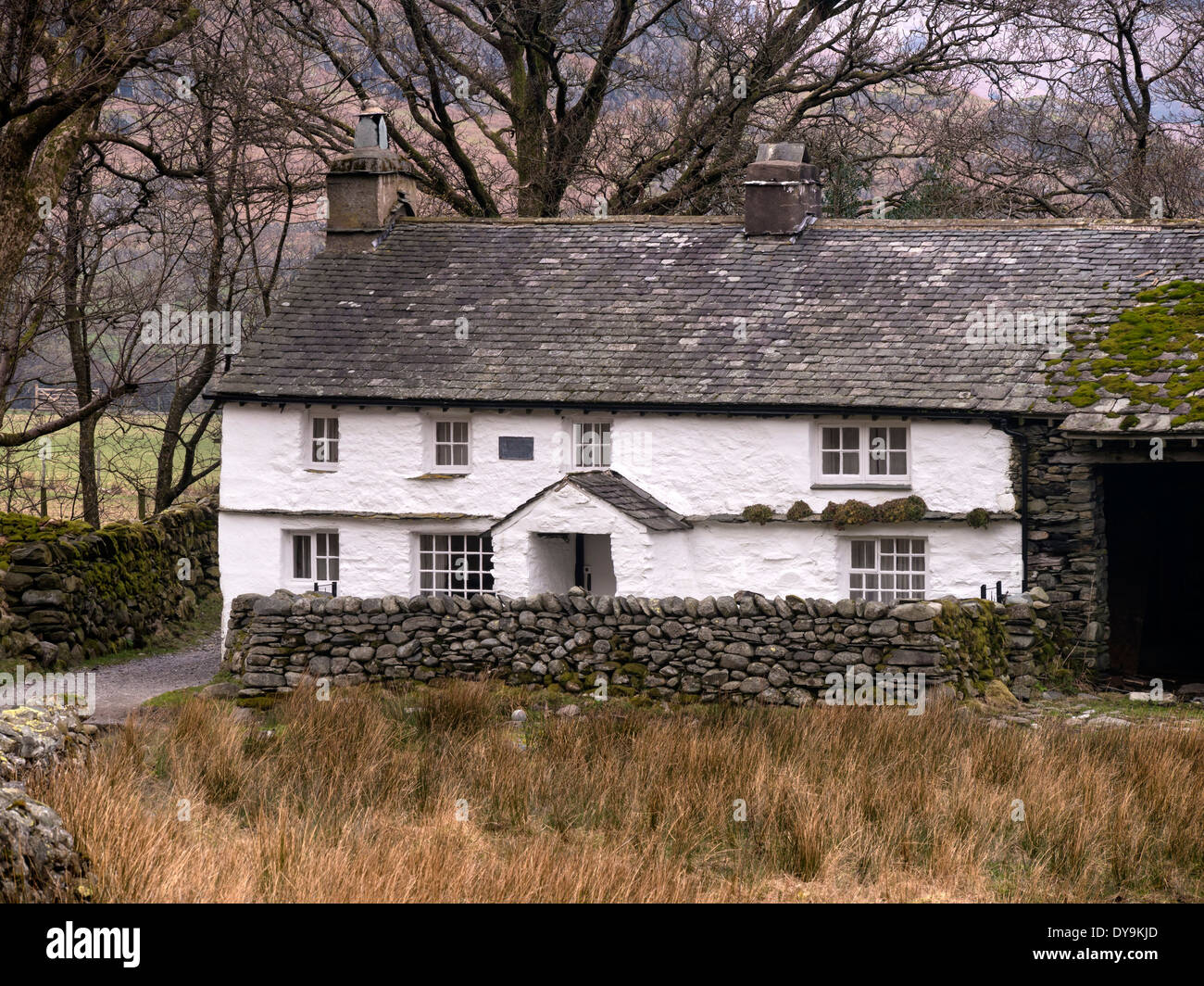Old White Washed Farm Cottage With Slate Roof And