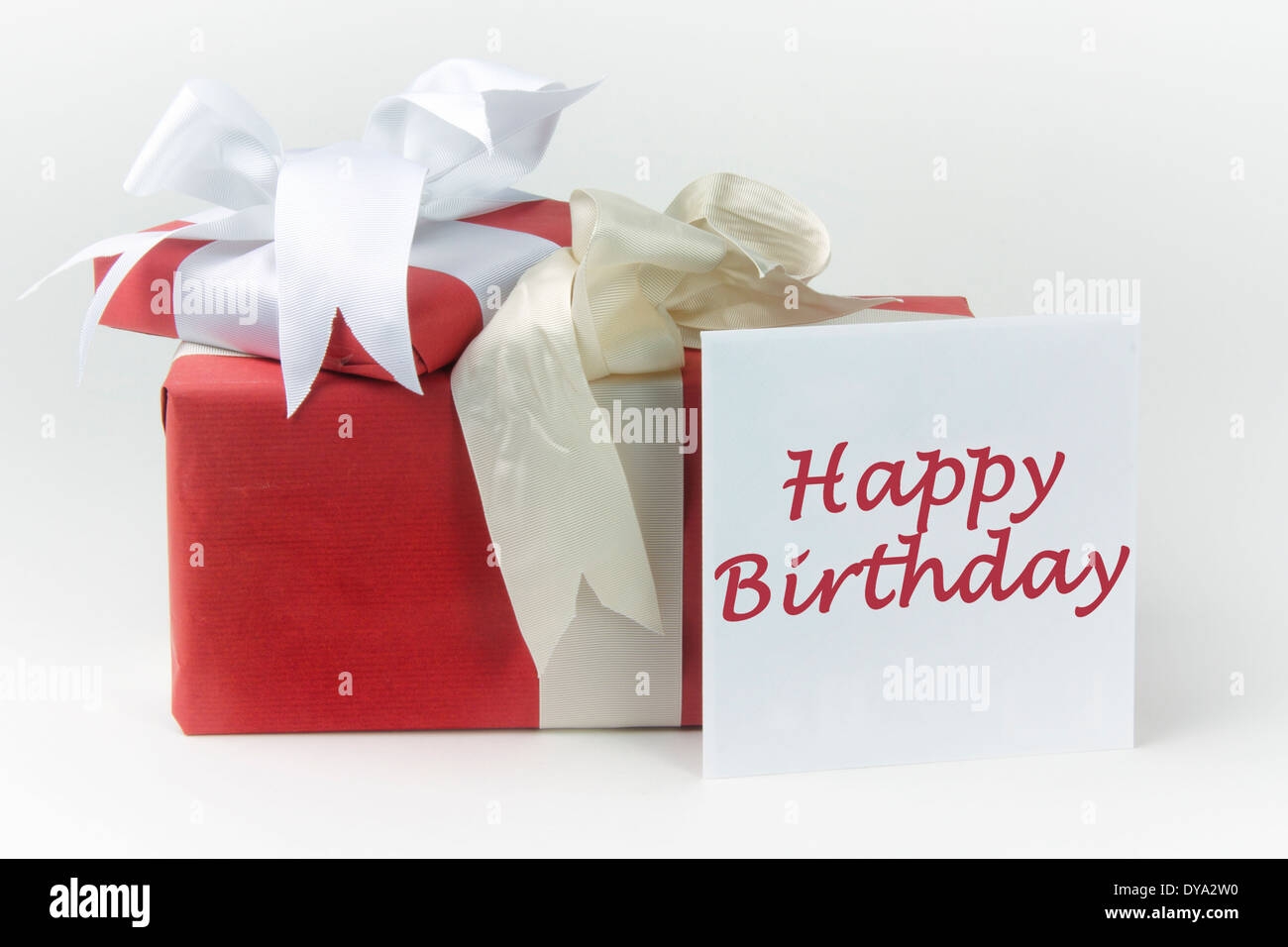 Two gift wrapped presents with bows plus a greeting card in an two gift wrapped presents with bows plus a greeting card in an envelope with the message happy birthday negle Choice Image