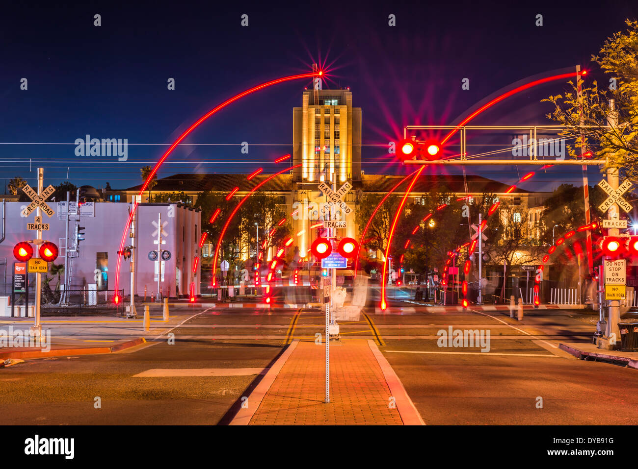 Blurred train crossing lights san diego county administration blurred train crossing lights san diego county administration center building in the background san diego california arubaitofo Image collections