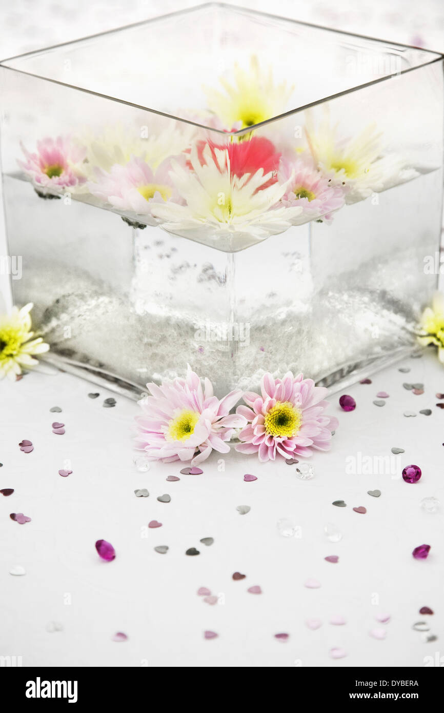 Wedding table centre display with a glass square vase with wedding table centre display with a glass square vase with floating flowers reviewsmspy