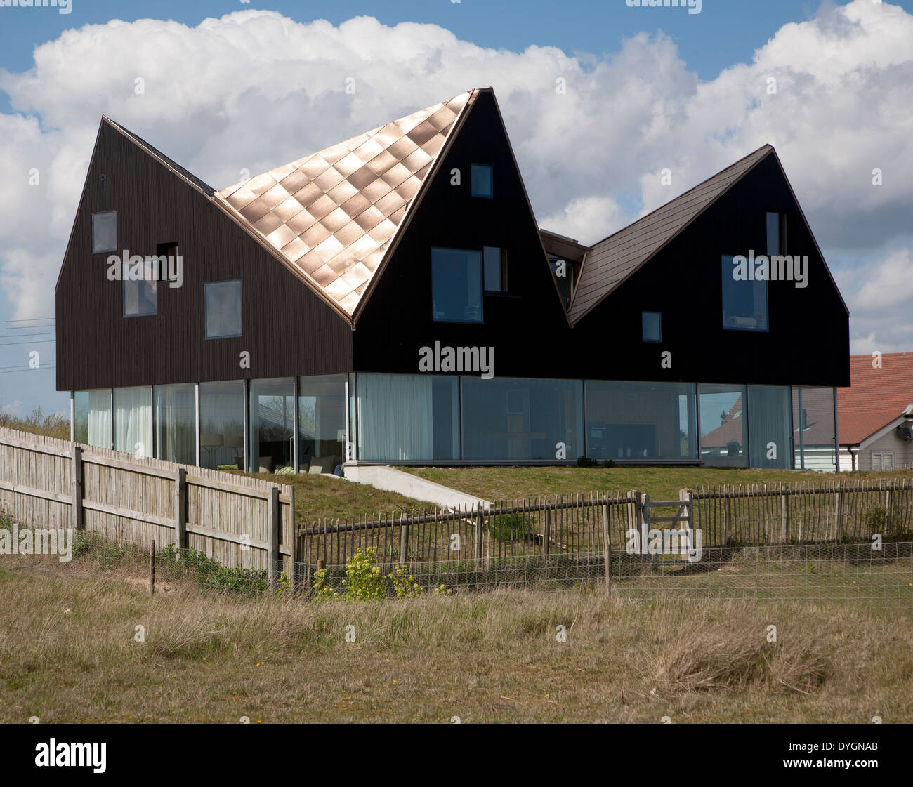 Sunshine shining on metal roof of modern house the dune house on the stock photo royalty free - The dune house the floating roof ...