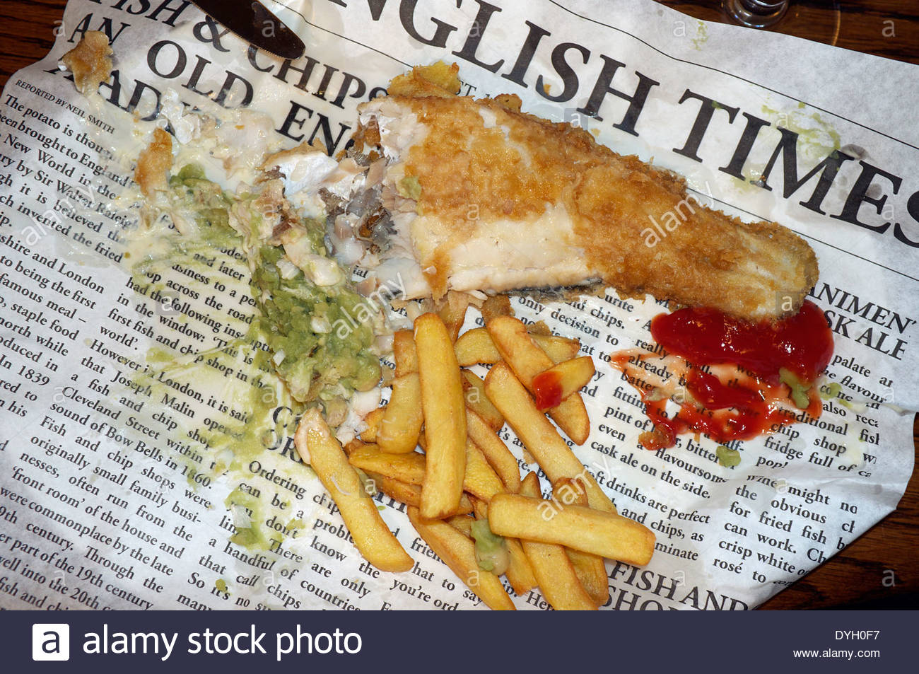 A nearly finished portion of battered cod chips mushy for Fish and chips newspaper