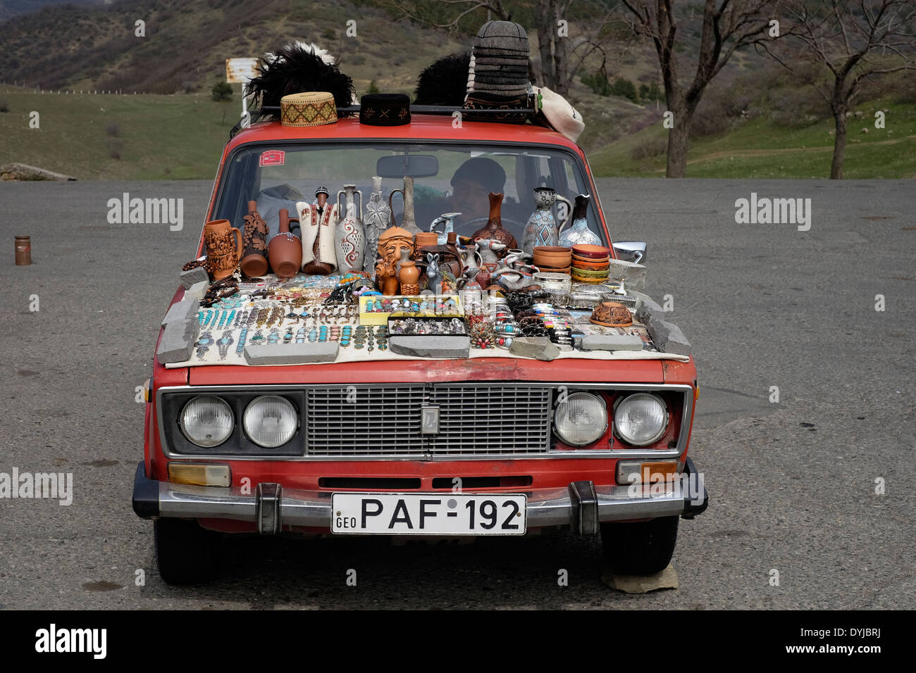 Souvenirs for sale on a hood of a lada car manufactured by the souvenirs for sale on a hood of a lada car manufactured by the russian car manufacturer avtovaz in the republic of georgia sciox Gallery