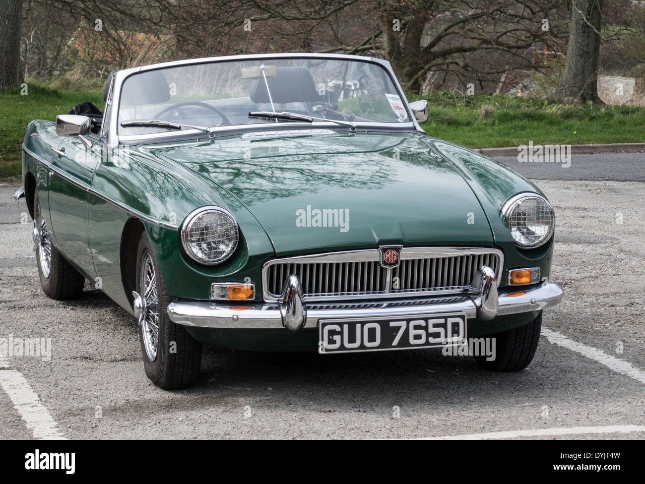A Classic British Racing Green Mg B Roadster Sports Car In