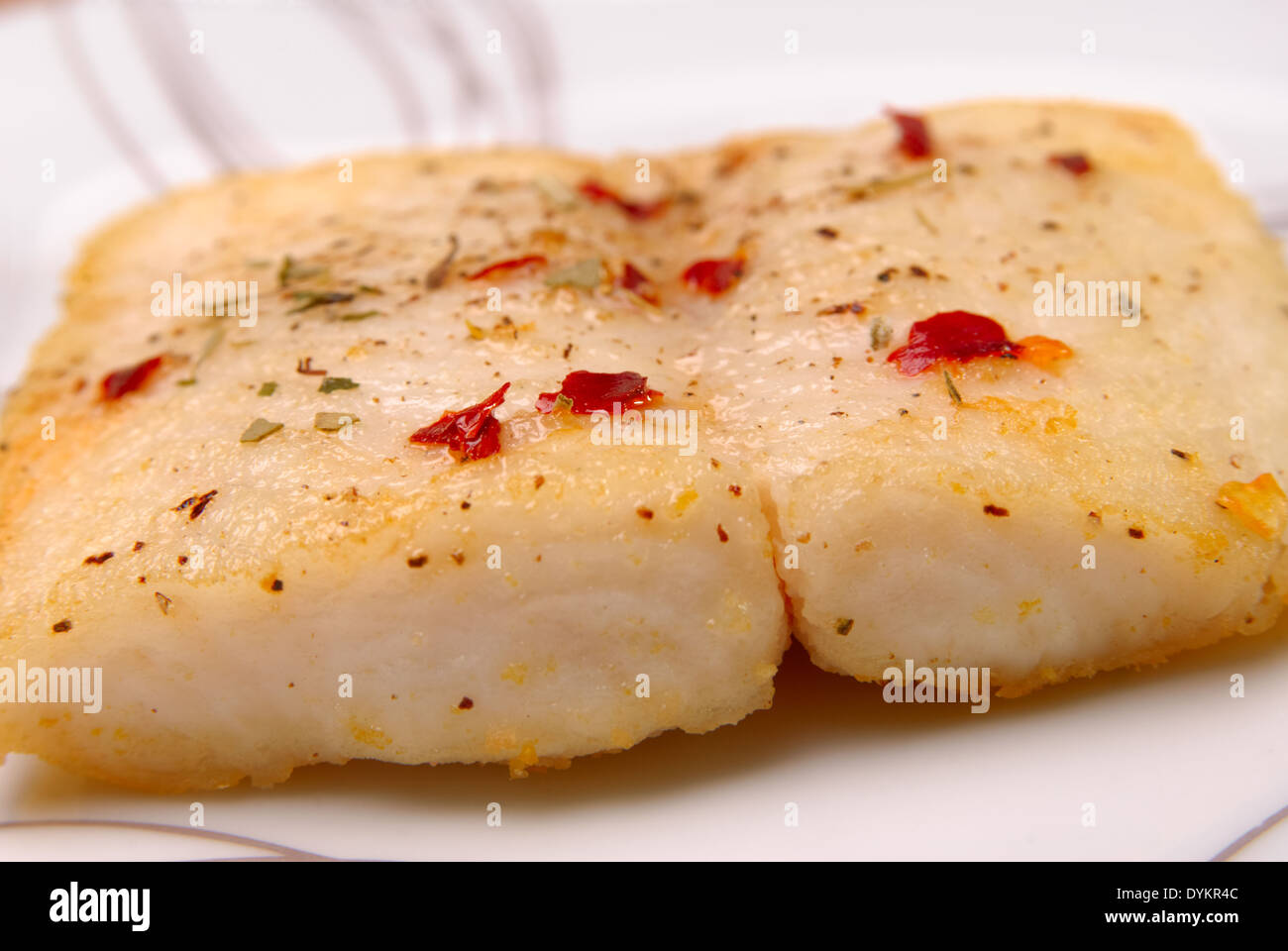 Catfish with aromatic herbs served on a white plate for Aromatic herb for fish
