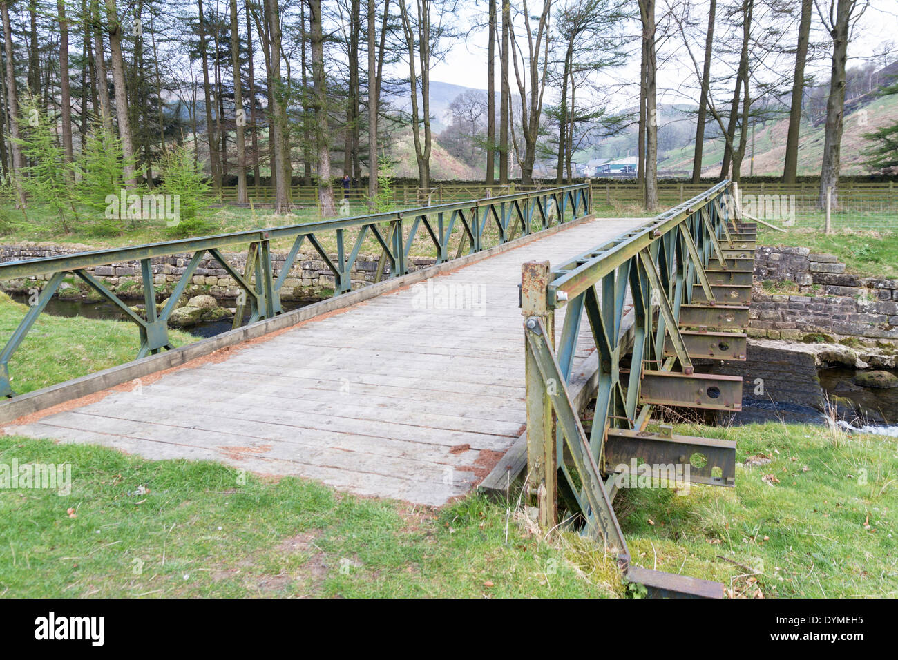 Small Portable Bridges : Old bailey bridge crossing a small river stock photo