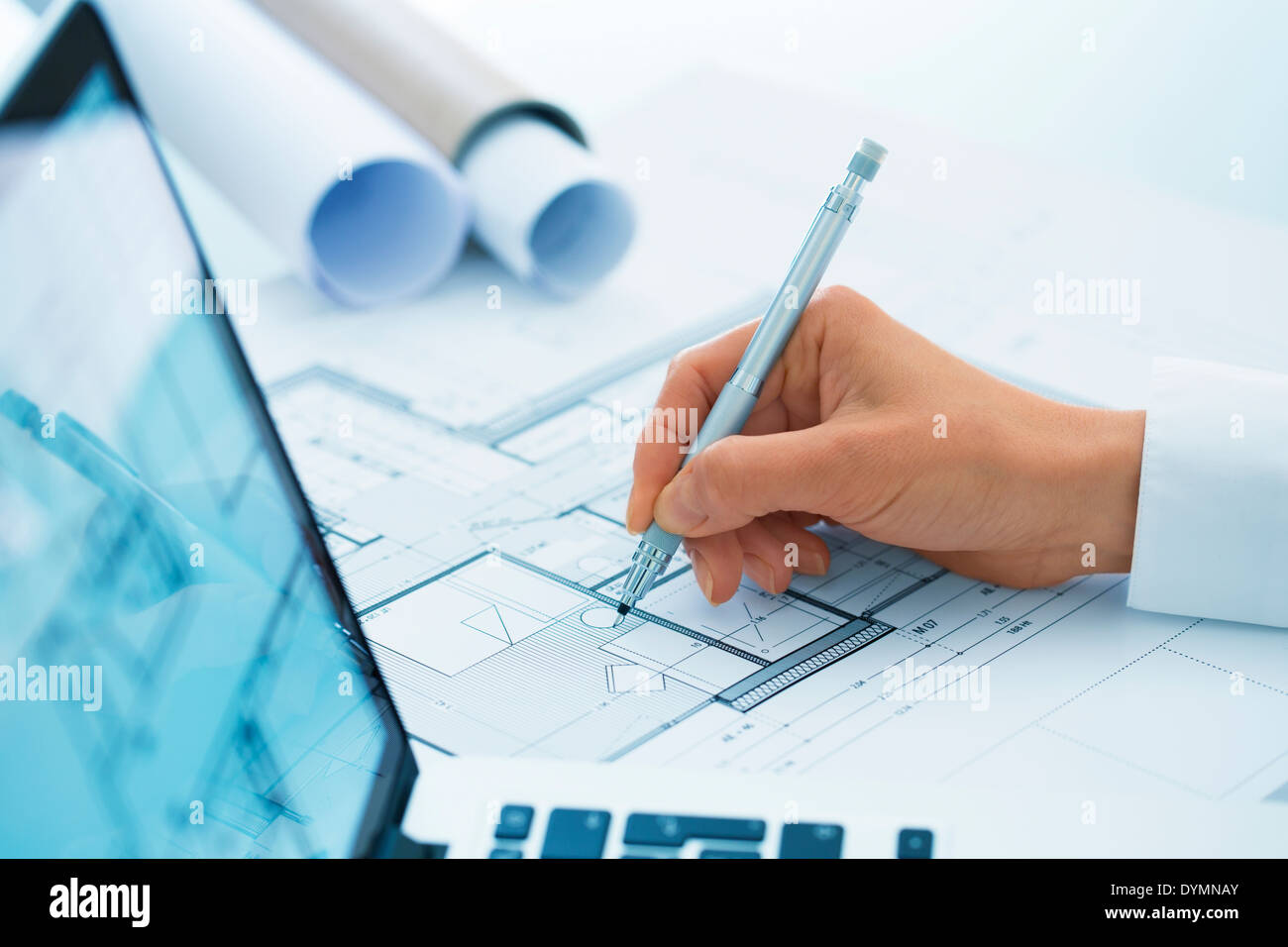 Architect drawing architectural project on blueprint engineering woman architect drawing on blueprint construction project stock photo malvernweather Image collections