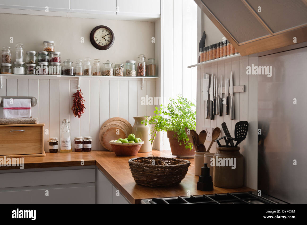 Open shelving and solid oak work surfaces in kitchen with for Wood paneling for kitchen walls