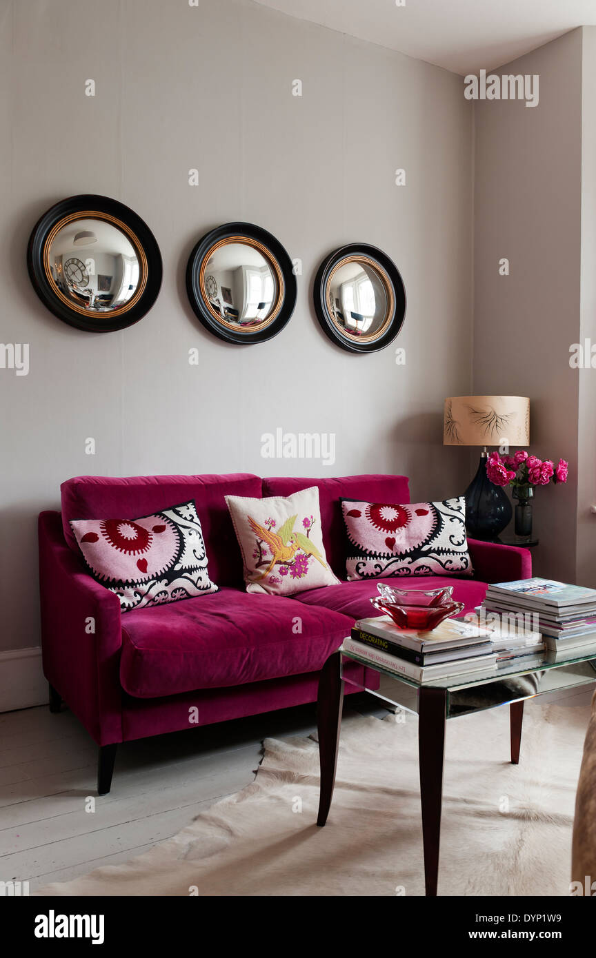 Exceptional Raspberry Coloured Velvet Furniture In Living Room With Graham And Green  Porthole Wall Mirrors