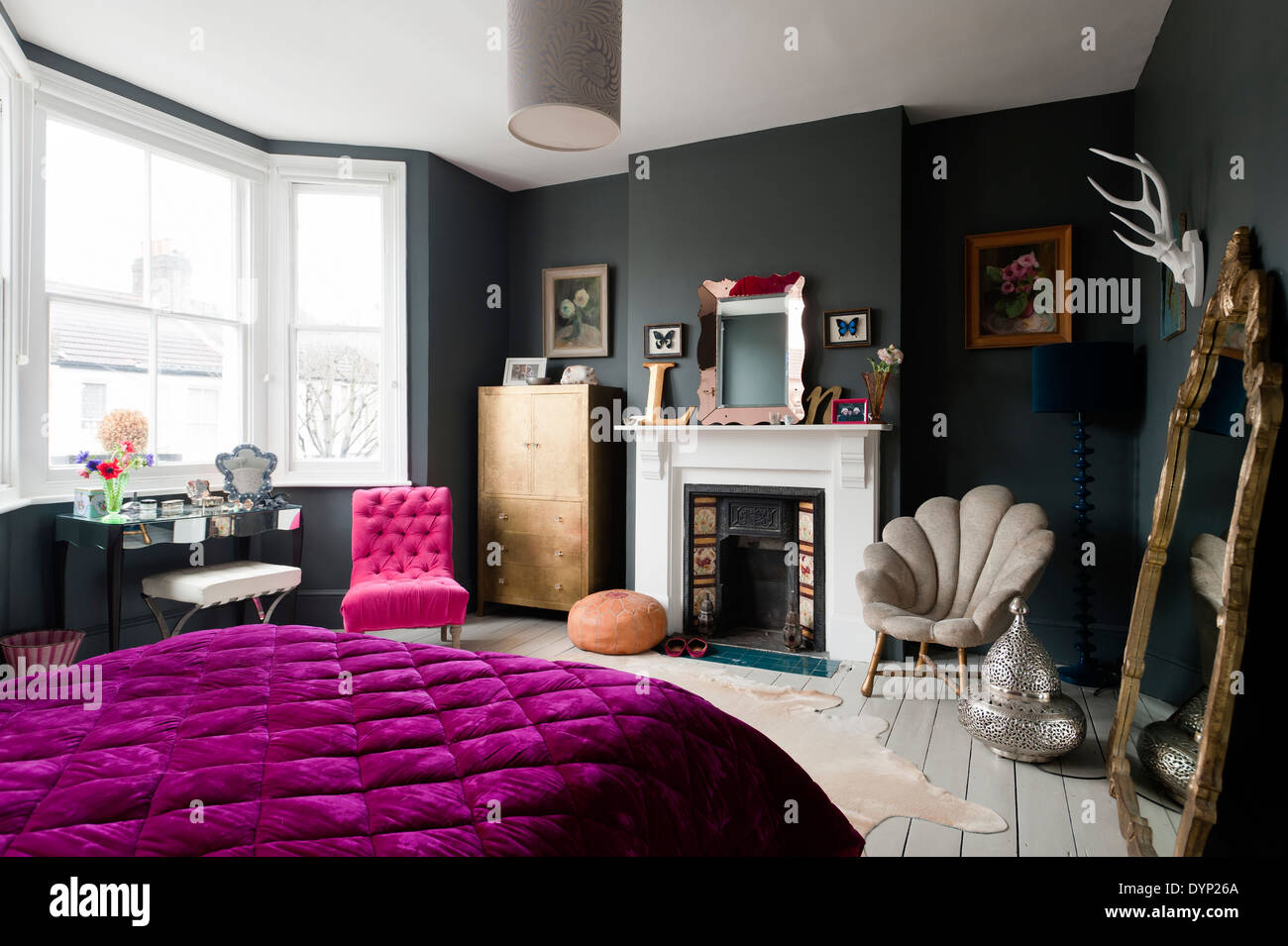 Dark painted bedroom with assorted vintage and graham and - Graham and green ...