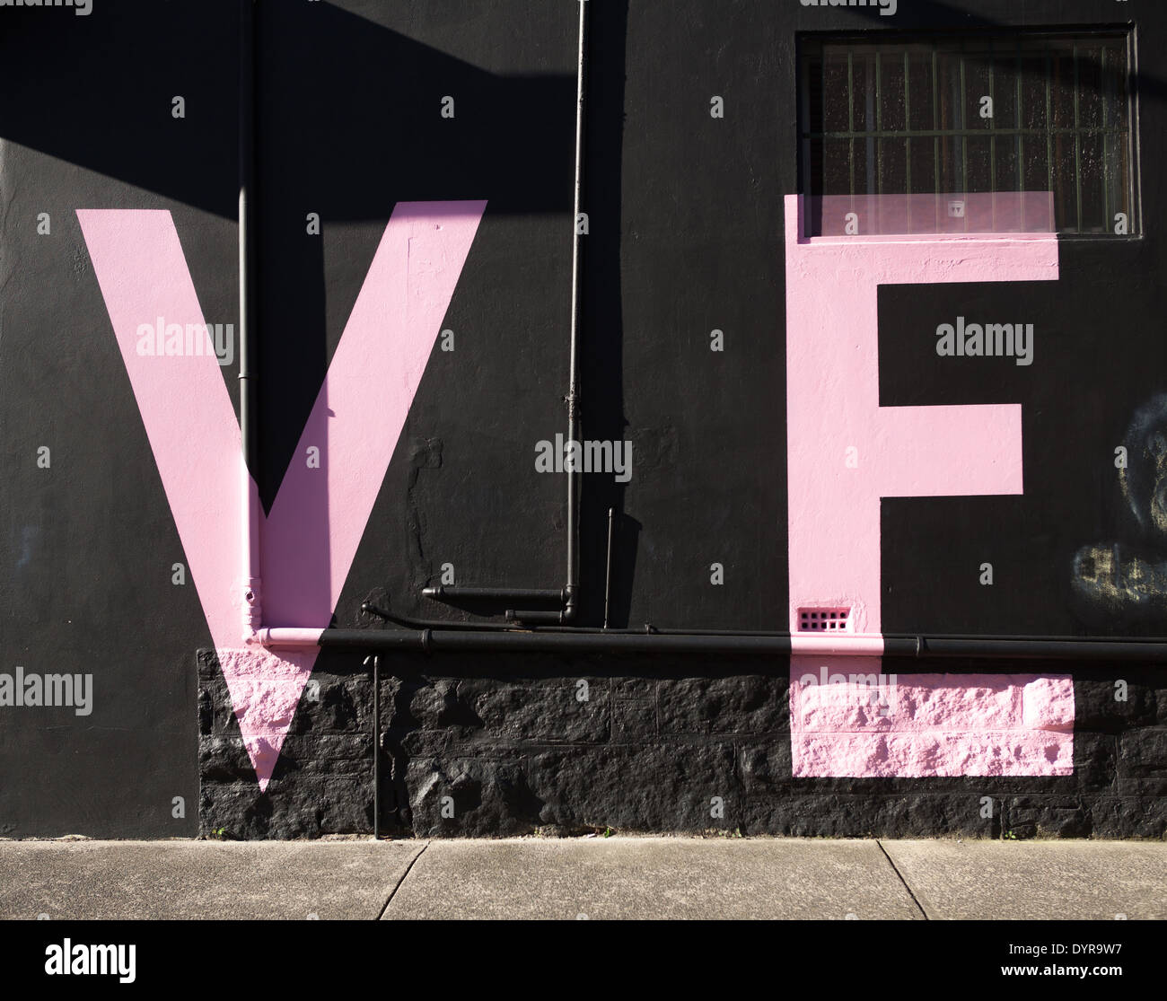 Black Wall Letters Letters V And E On A Black Wall In Pink Writing Stock Photo