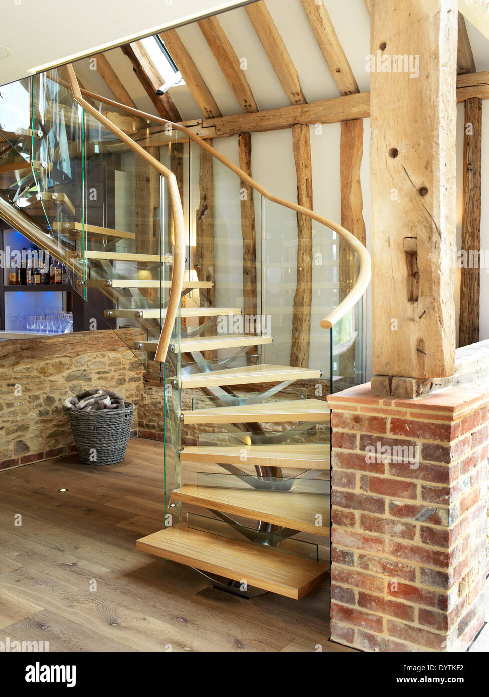 Wooden Flooring In Country Barn Conversion Beamed Living Room With