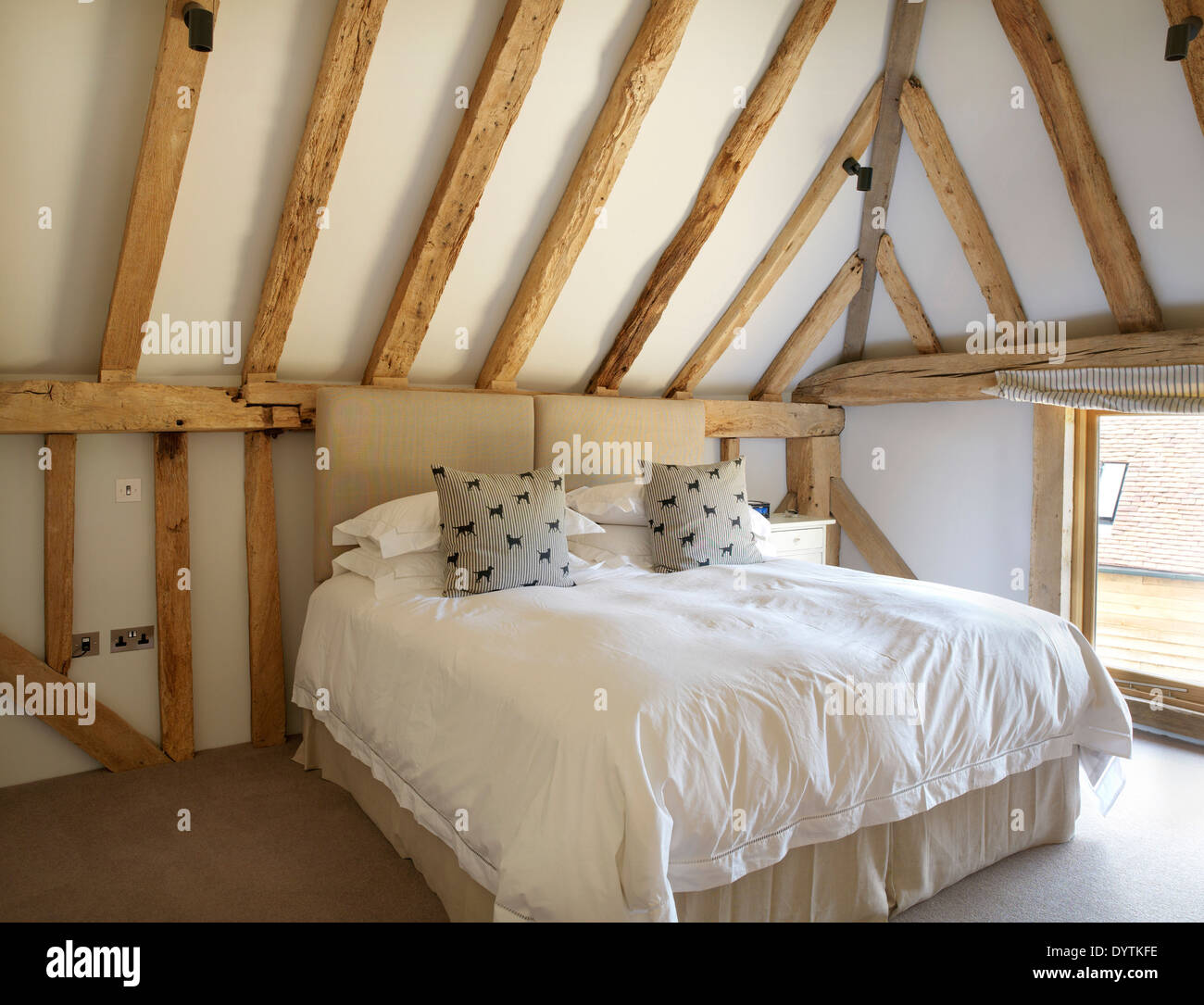Double bed in bedroom in barn conversion with exposed beams, Field Place  Barns, Surrey