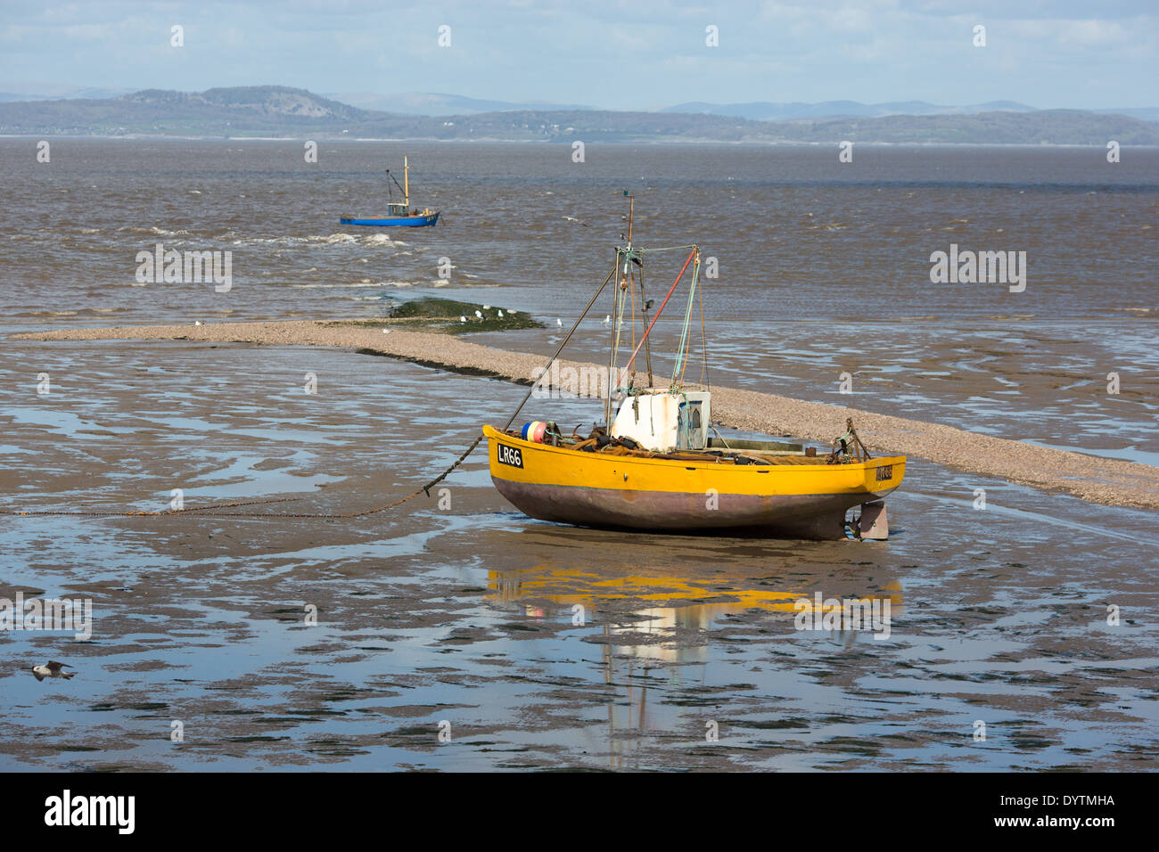 An inshore fishing boat waiting for the tide in morecambe for Tide for fishing