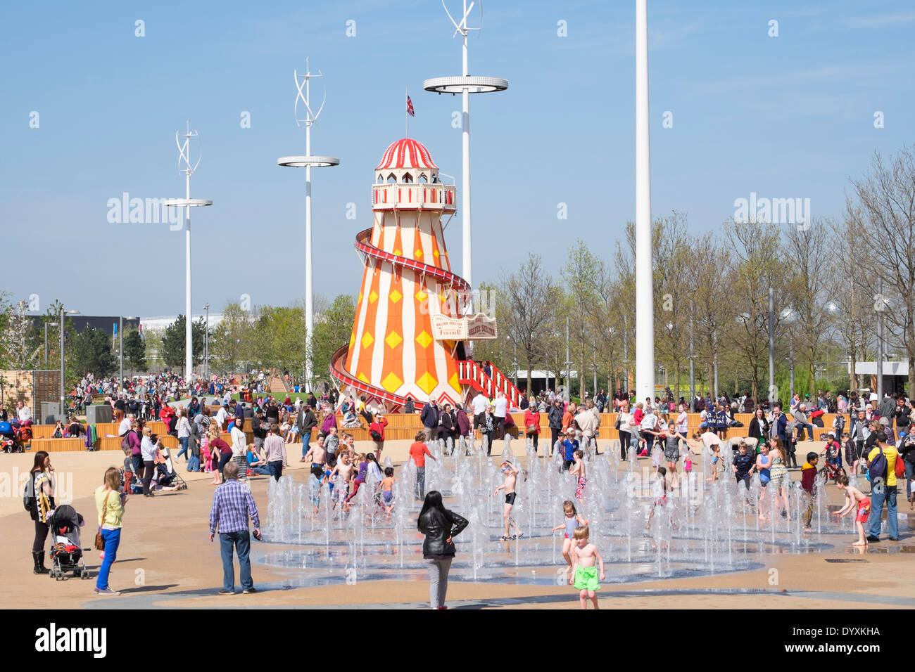 Helter Skelter Funfair And Fountain With Many Visitors At Queen Elizabeth Olympic Park In Stratford London
