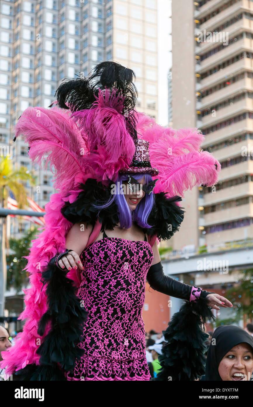 female-stilt-walker-in-colorful-costume-
