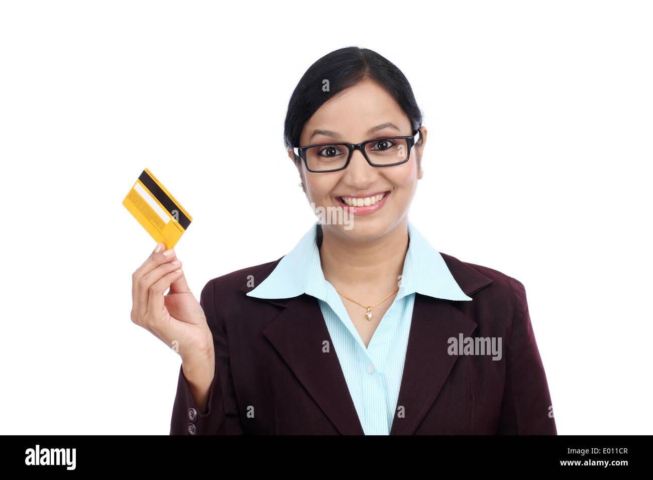 Happy young indian business woman with credit card against white happy young indian business woman with credit card against white background reheart Choice Image