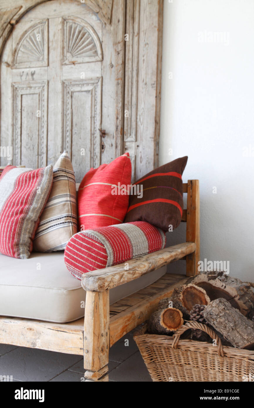 Exceptional Elegant Antique Timber Framed Seat Covered In Moroccan Style Cushions In  Front Of Antique Salvaged Door