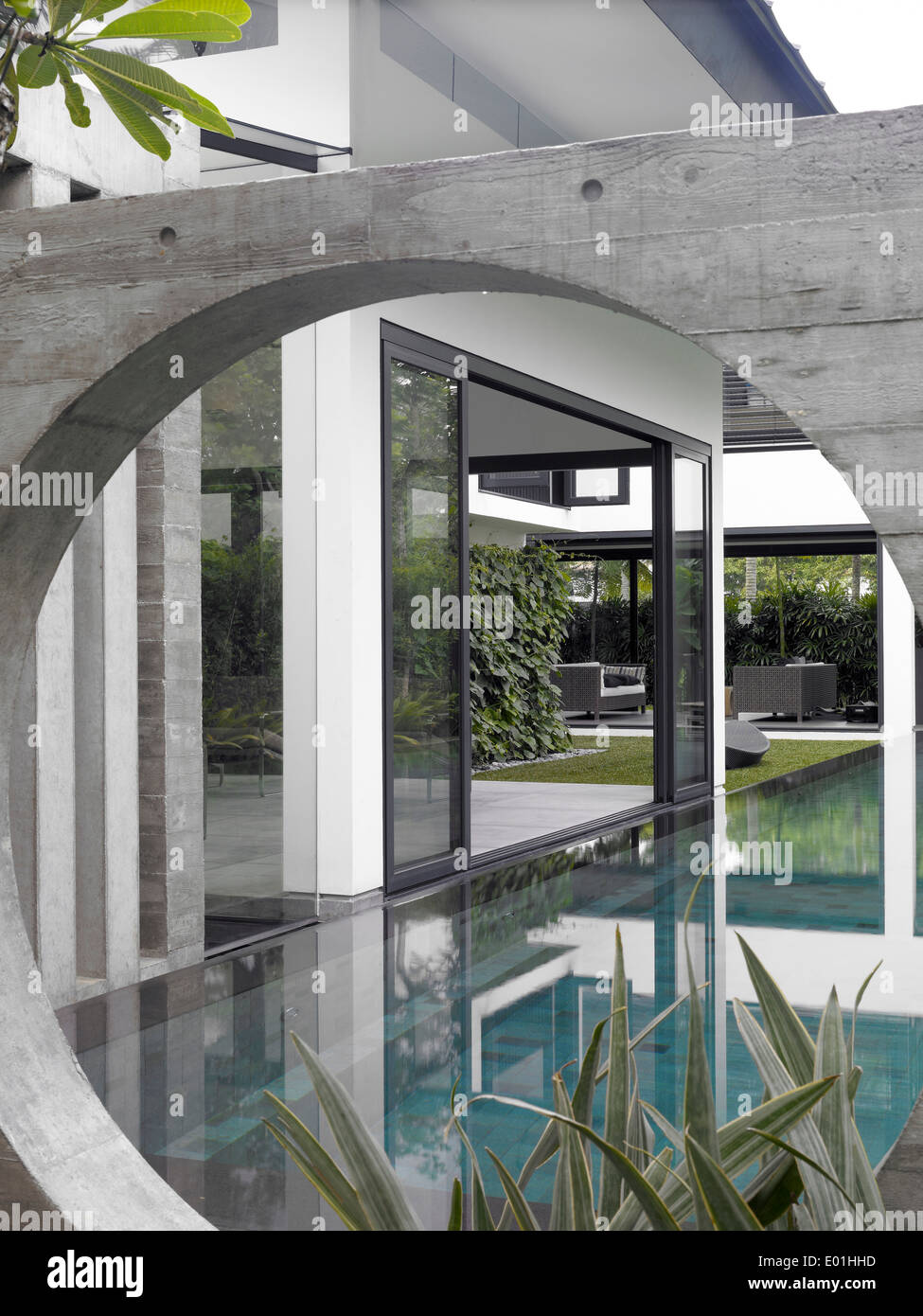 Arched water feature on exterior of modern house swiss for Exterior features of a house