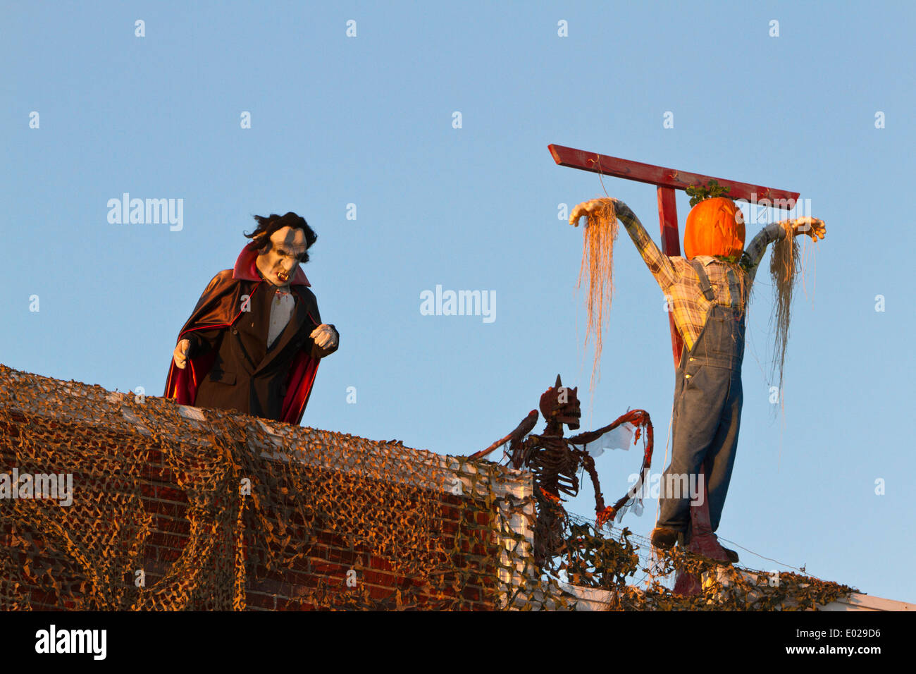 Vampire, demon and pumpkin man on cross (Halloween decoration ...