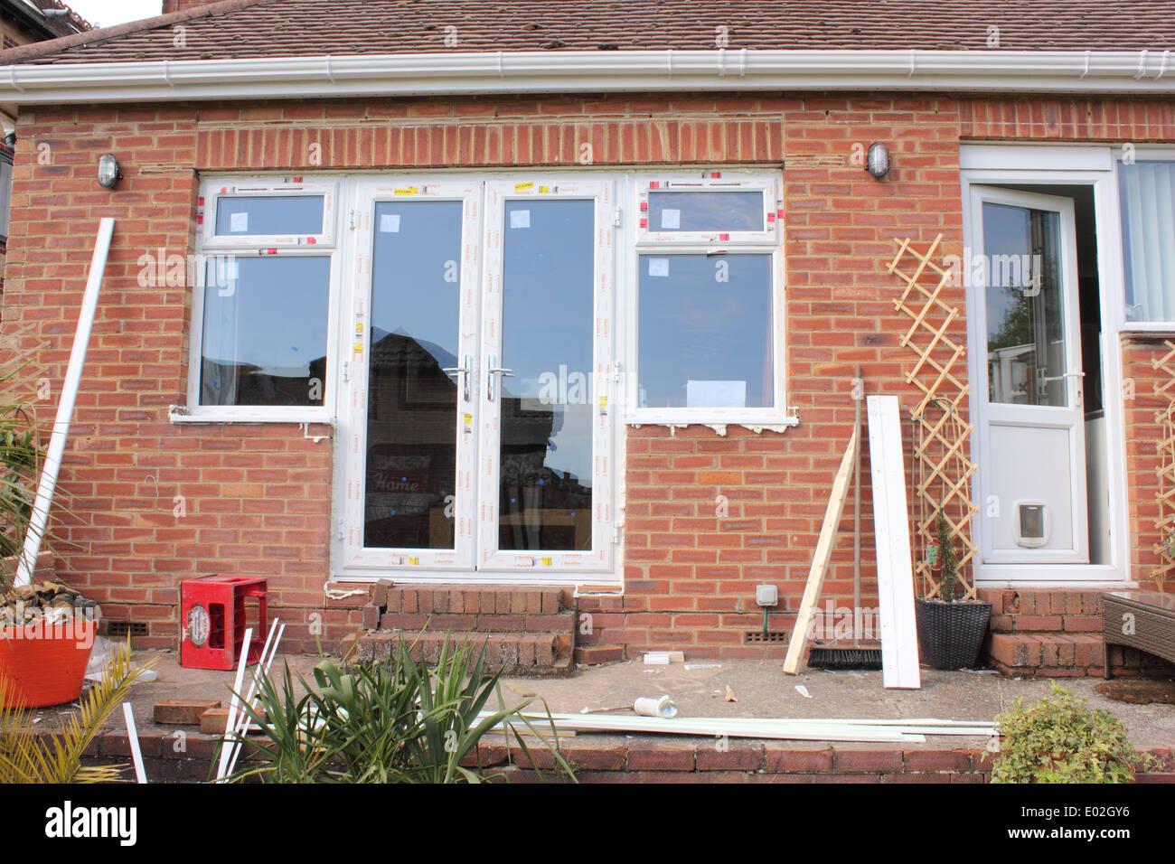 Installation of new plastic doors and windows to a bungalow & Installation of new plastic doors and windows to a bungalow Stock ...