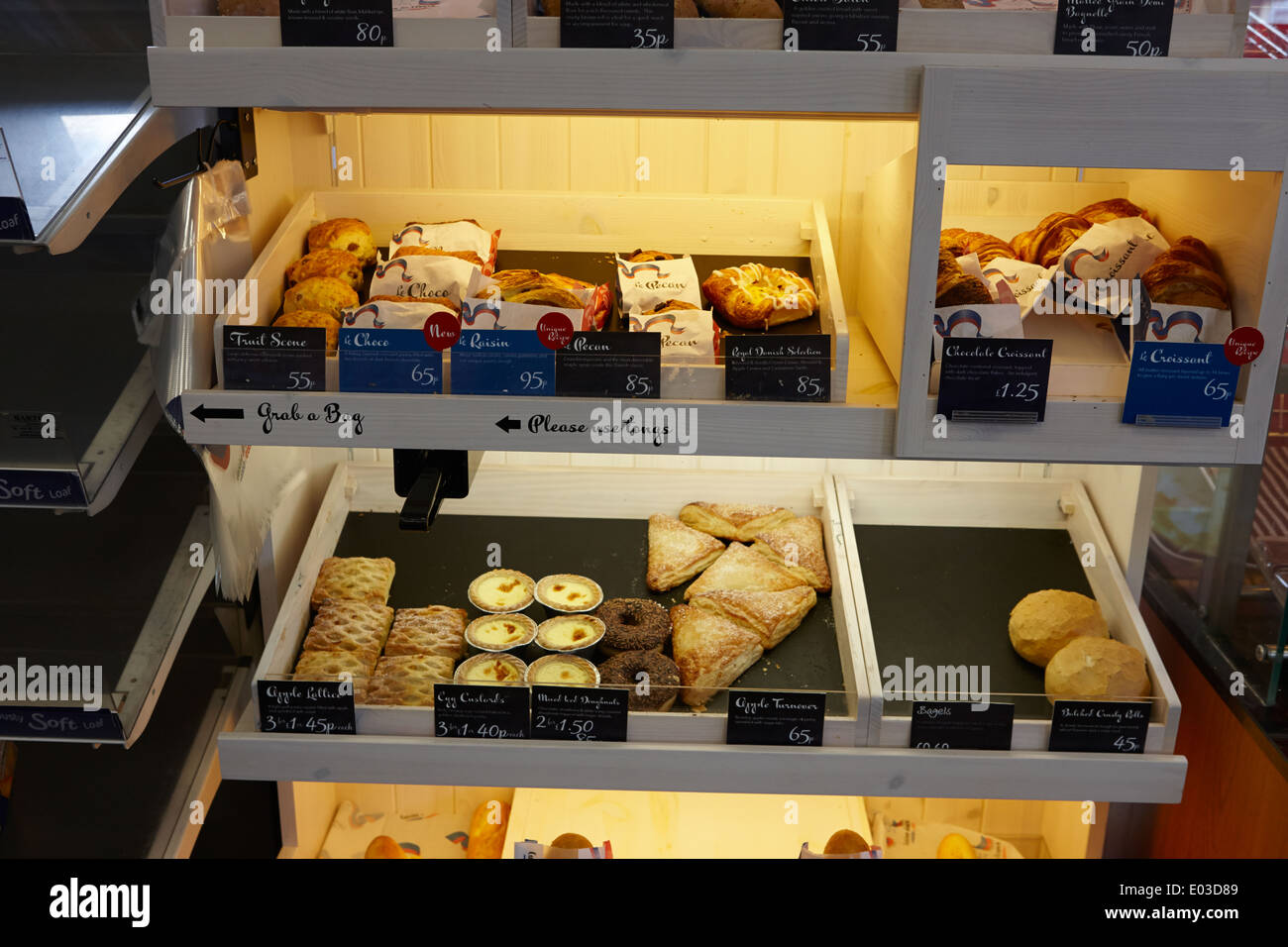 cuisine de france pastries on display in a filling station stock