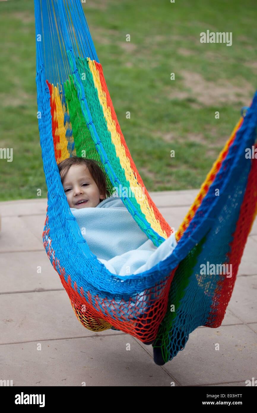 little boy in a colorful hammock little boy in a colorful hammock stock photo royalty free image      rh   alamy