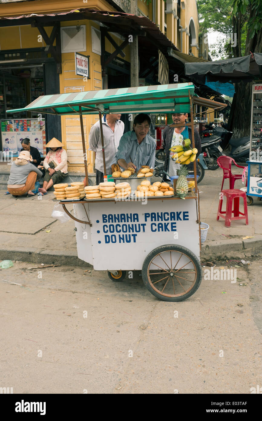 Stock Photo - Fast Food Street Stall selling Pancakes Donuts in the Old Town Hoi An Vietnam