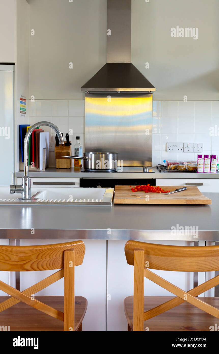 modern kitchen interior with cooker and stainless steel extractor