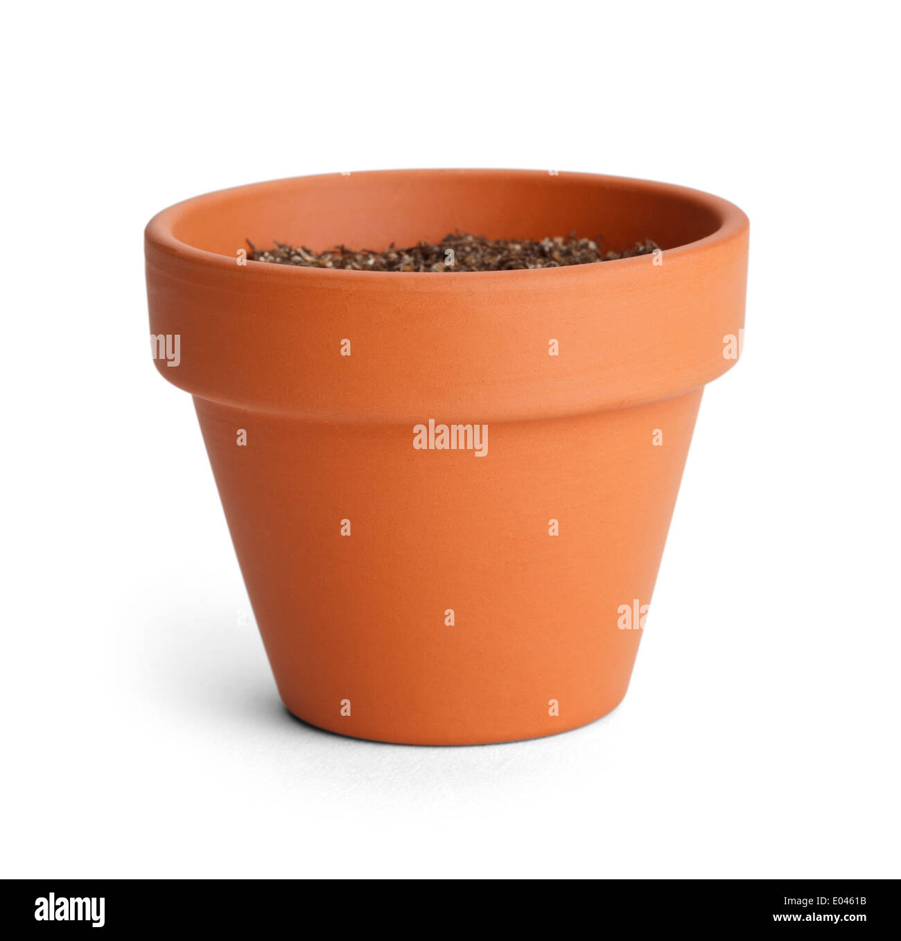 Orange terracotta pot with soil isolated on white for Clay potting soil