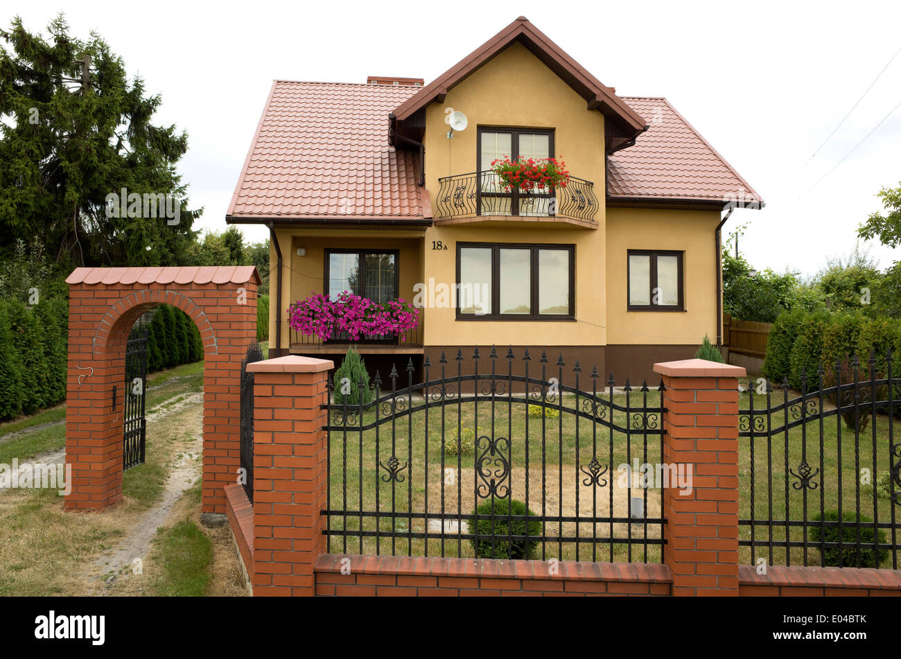 Modern Polish House With Wrought Iron Fence With Brick