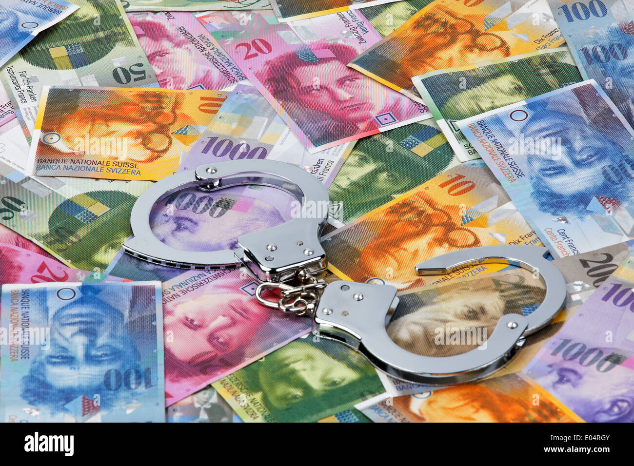 swiss francs money of switzerland with handcuffs schweizer franken stock photo royalty free. Black Bedroom Furniture Sets. Home Design Ideas