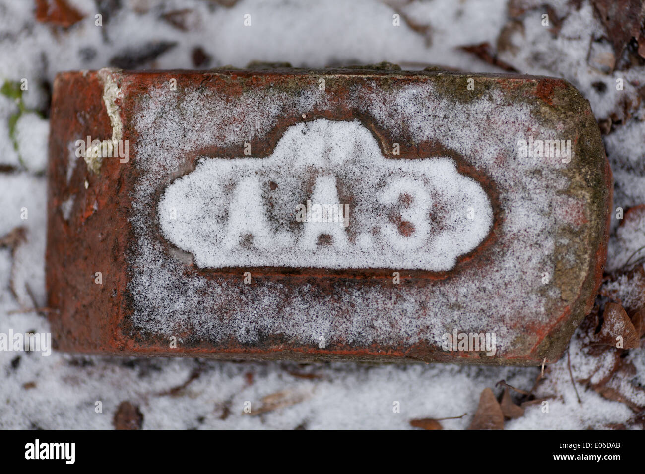 Old brick with letters lightly covered with snow stock photo old brick with letters lightly covered with snow madrichimfo Images