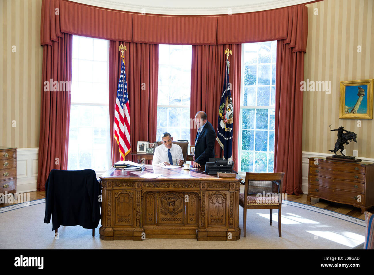 us president office. US President Barack Obama Works In The Oval Office With Ben Rhodes, Deputy National Security Advisor For Strategic Communications, On Remarks Us