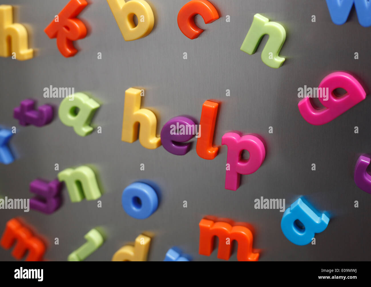 help spelled out in plastic magnetic letters on a fridge