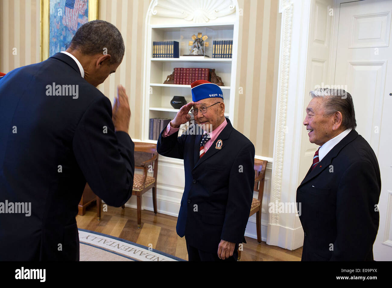 stock photo us president barack obama returns the salute from tommie okabayashi one of the members of the group of japanese american wwii veterans barak obama oval office golds