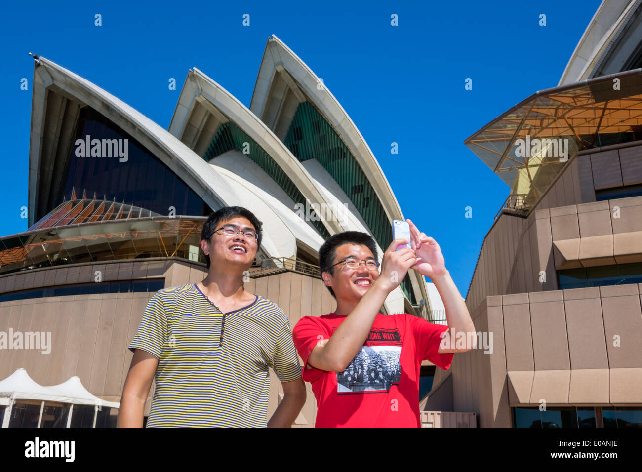 House design nsw - Stock Photo Sydney Australia Nsw New South Wales Sydney Harbour Harbor Sydney Opera House Design Shell Roof Ceramic Tile Asian Man Friend Taking Picture